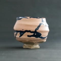 Pink and blue ceramic drinking cup